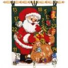 kruissteekwandkleed kerstman deelt uit…